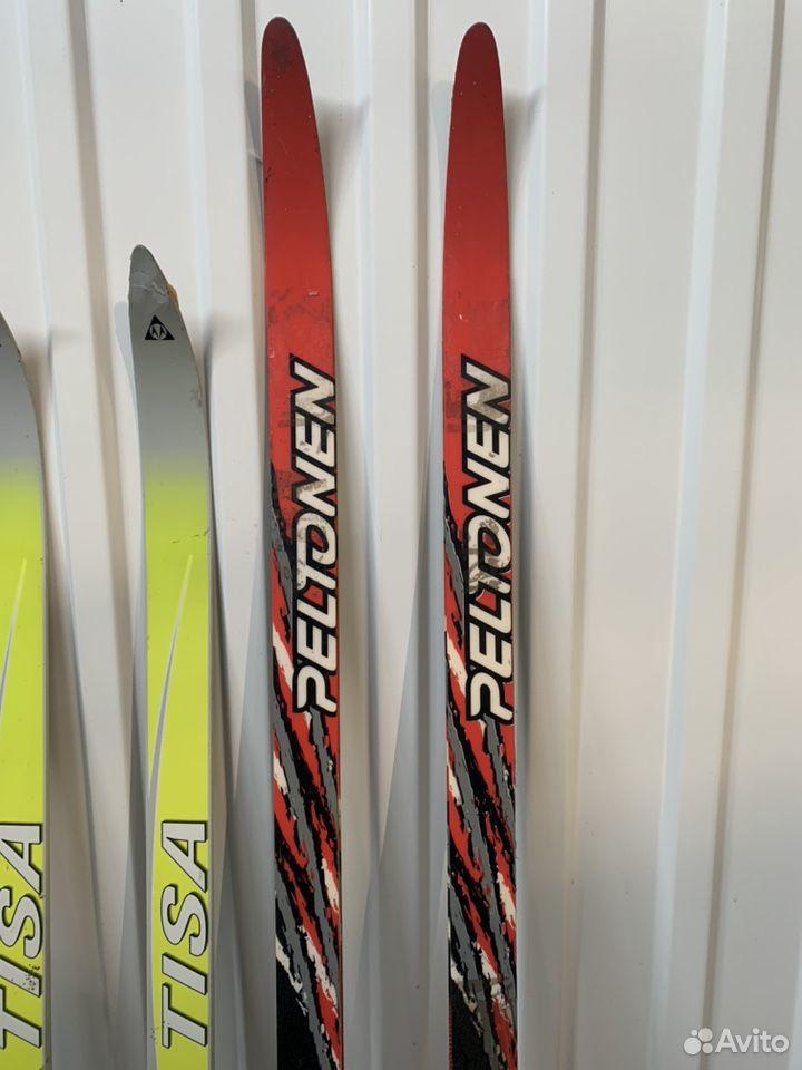 Продам две пары пластиковых лыж с палками и ботинк